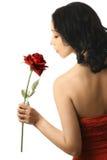 El perfil de la mujer con rojo se levantó Foto de archivo