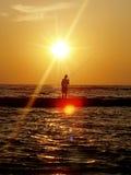 El pescar con caña en el mar Fotos de archivo libres de regalías