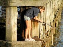 El pescar con caña femenino fotografía de archivo