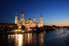 El Pilar Basilica (Zaragoza, Spain). El Pilar basilica by the Ebro River. Night scene. (Zaragoza, Spain stock image