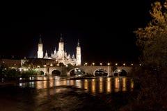 El Pilar cathedral in Zaragoza with the stone bridge Royalty Free Stock Photo