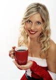 El Pin encima de la muchacha de santa bebe el café Imágenes de archivo libres de regalías