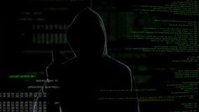 El pirata informático anónimo amenaza a la seguridad del mundo, datos confidenciales sin la protección almacen de video