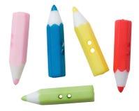 El plástico multicolor dibuja con creyón el botón Fotos de archivo libres de regalías