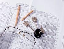 El plan del edificio, lápiz, llave imagen de archivo