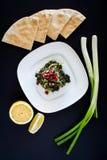 El plato verde llamó el khobbeizeh de Ø© del ² de Ø®Ø¨ÙŠØ Imágenes de archivo libres de regalías