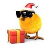 el polluelo de 3d Pascua celebra la Navidad con un regalo Imagen de archivo