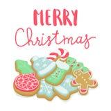 el poner letras de las galletas de la Navidad del invierno Foto de archivo libre de regalías