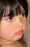 El poner mala cara Foto de archivo libre de regalías