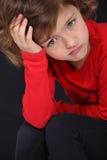 El poner mala cara de la niña Imagen de archivo libre de regalías
