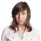El poner mala cara triste de la mujer joven Foto de archivo libre de regalías