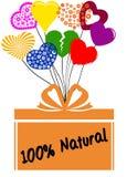 El 100 POR CIENTO de NATURAL en la caja de regalo con los corazones multicolores Foto de archivo libre de regalías