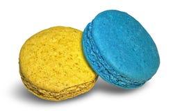 El postre dulce del macaron colorido de la galleta se apelmaza en fondo Fotografía de archivo libre de regalías