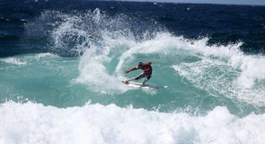 El practicar surf de Newcastle Fotografía de archivo libre de regalías