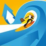 El practicar surf en las ondas del negocio imágenes de archivo libres de regalías