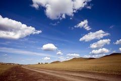 El prado resuelve el cielo Imagen de archivo libre de regalías