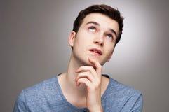 El preguntarse del hombre joven Imagen de archivo