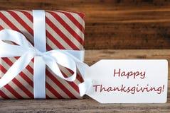 El presente con la etiqueta, manda un SMS a acción de gracias feliz Fotografía de archivo