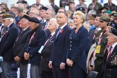 El presidente polaco Andrzej Duda y su esposa participa en el cerminia para el 75.o aniversario de fotos de archivo libres de regalías
