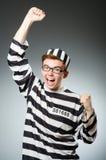 El preso divertido en concepto de la prisión fotografía de archivo