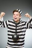 El preso divertido en concepto de la prisión imágenes de archivo libres de regalías