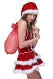 El primer de la muchacha en la alineada de santa y los regalos empaquetan Imagen de archivo libre de regalías