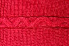 El primer del rojo hizo punto textura de las lanas Fotos de archivo libres de regalías