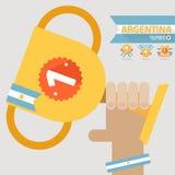 El primer premio del ganador en la mano con la bandera de la Argentina Imágenes de archivo libres de regalías