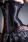 El primer tiró de mujer elegante en corsé negro Foto de archivo libre de regalías