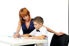 El profesor ayuda al estudiante Foto de archivo