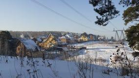 El pueblo del día de fiesta en invierno Foto de archivo libre de regalías