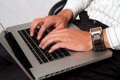 El pulsar en la computadora portátil Fotografía de archivo