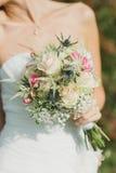 El ramo de la boda con el anillo en subió Fotografía de archivo libre de regalías
