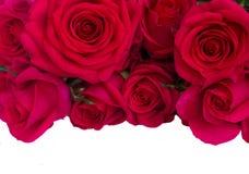 El ramo de rosas rosadas oscuras se cierra para arriba Foto de archivo