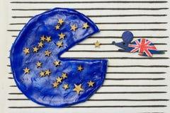 El ratón británico comió un pedazo de pizza europea fotografía de archivo libre de regalías