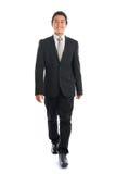 El recorrer asiático del hombre de negocios Imagen de archivo libre de regalías