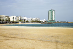 El Reducto beach in Arrecife (Lanzarote). Urban beach of Arrecife, capital city of Lanzarote with a tower standing out of the skyline Stock Photography