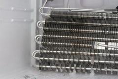 El refrigerador kichen arreglo del dispositivo de la bobina de la reparación Fotos de archivo libres de regalías