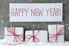 El regalo blanco con los copos de nieve, manda un SMS a Feliz Año Nuevo Imagenes de archivo