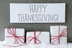 El regalo blanco en nieve, manda un SMS a acción de gracias feliz Foto de archivo libre de regalías