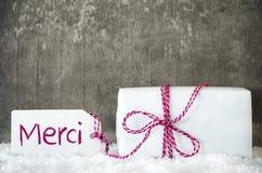 El regalo blanco, nieve, etiqueta, medios de Merci le agradece imagen de archivo libre de regalías