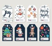 El regalo de la Navidad y del Año Nuevo marca con etiqueta y las tarjetas Fotos de archivo