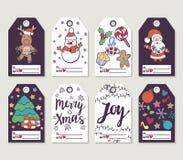 El regalo de la Navidad y del Año Nuevo marca con etiqueta y las tarjetas Fotografía de archivo libre de regalías