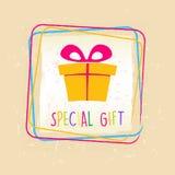 El regalo especial con la actual caja firma adentro el marco sobre viejo backg de papel Foto de archivo libre de regalías