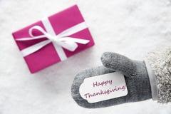 El regalo rosado, guante, manda un SMS a acción de gracias feliz Fotografía de archivo