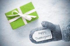 El regalo verde, guante, manda un SMS a la acción de gracias feliz, copos de nieve Foto de archivo libre de regalías