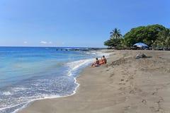 El relajar en la playa fotos de archivo libres de regalías