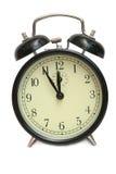El reloj de alarma negro Imagenes de archivo