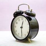 El reloj en estilo retro Imagen de archivo libre de regalías