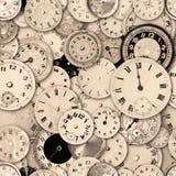 El reloj hace frente a la sepia que repite el fondo Fotografía de archivo libre de regalías